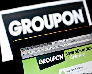 Groupon Spikes Before Earnings, Tesla Soars on Analyst Comments -- Tech Winners & Losers