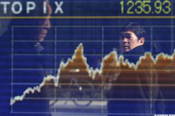 Asian Markets Mixed as Stock Futures Point to U.S., U.K. bounce