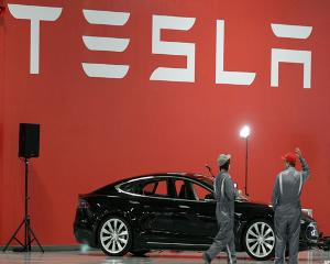 Tesla Falls on New Worries, NXP and Freescale Soar on Merger: Tech Winners & Losers